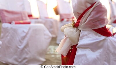 decorated chairs with bows - white chairs decorated with red...