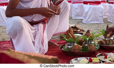 brahmins prepareing place for Indian wedding ceremony -...
