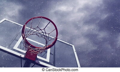 Basketball hoop with cage with snowfall and Time lapse dark...