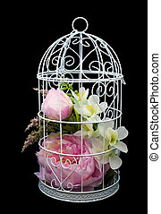 Beautiful lilac flowers in decorative cell, on black...