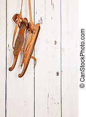 Old Dutch skates hanging at the wooden wall