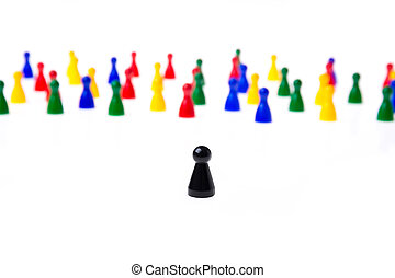 Several game pawns in different colors on a white background...