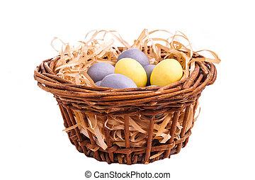 Ester egg in basket, isolated on white