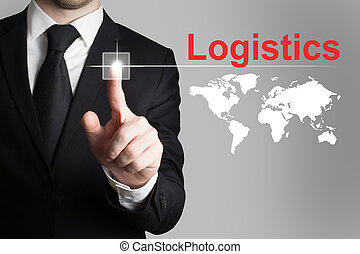 businessman pushing button logistics - businessman in black...