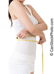 reduce weight - Asian woman measuring herself with measure...
