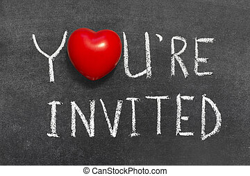 you are invited phrase handwritten on blackboard with heart...