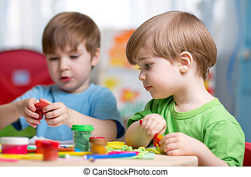 kids with play clay at home - kids playing with play clay at...