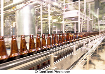 Beer conveyor - Beer bottles on the conveyor belt