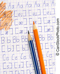 alphabet - exercise book page with letters and transcription...