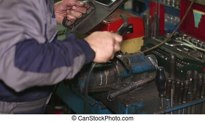 Welder with Welding Electrode on the Workbench Vice. Welder...