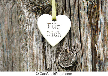 heart on tree bark with german inscription: for you
