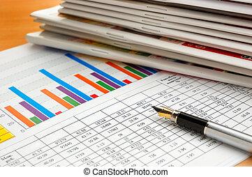 Fountain pen on stock chart