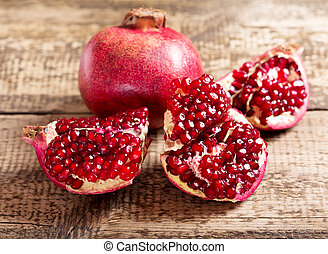 pomegranate - fresh pomegranate on wooden table