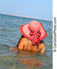 woman in hat on beach
