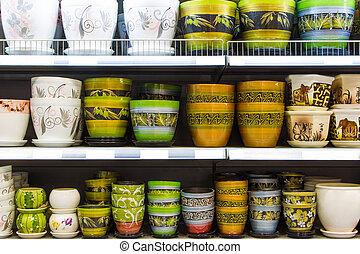 Flowerpots - New colored flowerpots in a shelf in a market