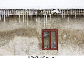 Icicles on the roof - Icicles hanging off a roof in the...