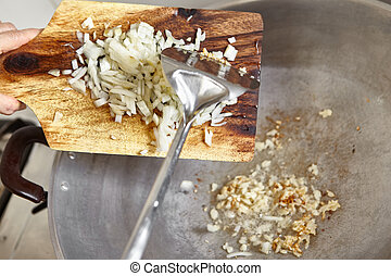 Fry onion - Frying the onion on the wok along with garlic