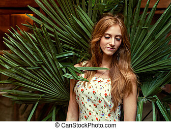 fashion girl in tropical palm leaves