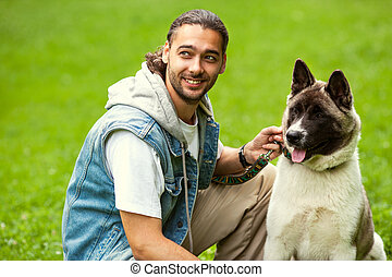 man with his dog breed Aki