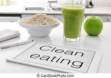 clean eating: oatmeal, apple, smoot - a tablet with the text...