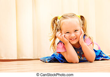 carelessness - Pretty little girl playing at home. Happy...