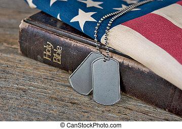 dog tags on Bible and flag - Military dog tags on worn Bible...