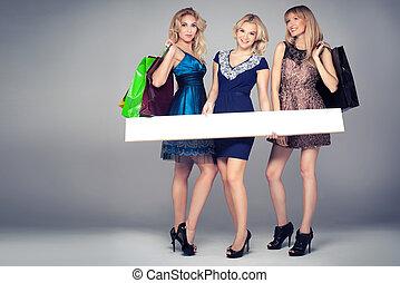 Smiling girls shopping. - Three beautiful girls shopping....