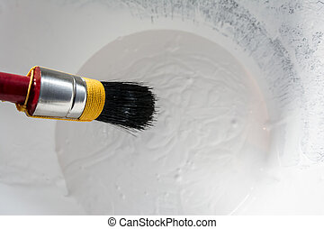 Paint brush in paint bucket