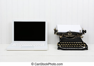Modern Laptop and Antique Typewriter - Closeup of a white...