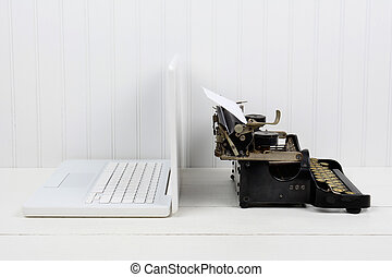 Back to Back Technology - Closeup of a white desk with a...