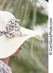 Happy woman with hat on summer