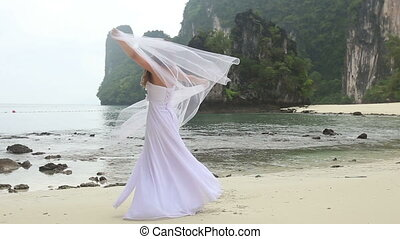 blonde bride long haired turns round  barefoot with veil