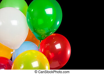 Assorted balloons on a black background
