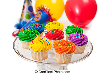 Cupcakes, balloons and party hats on a white background -...