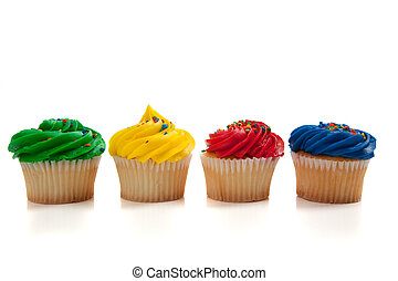 Rainbow colored cupcakes - Various colored cupcakes on a...