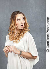 surprized girl with mouth opened in amazement - portrait of...