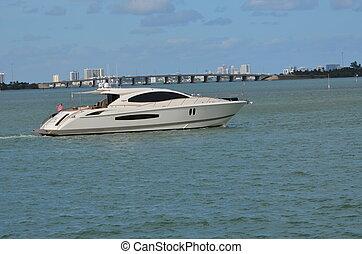 White Yacht - White yacht slowly cruising the florida...