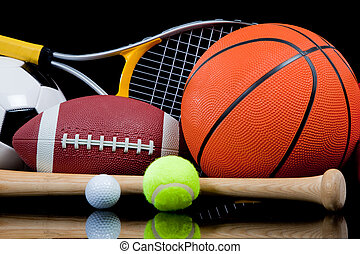 Assorted Sports Equipment on Black - A group of sports...