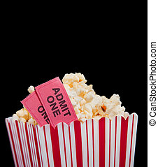 Movie ticket and popcorn on a black background - Popcorn and...