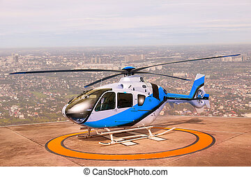 helicopter parking on building roof top use for commercial...