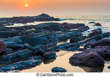 beautiful seascape and rocky shore at sunset