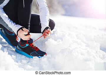Man jogging in winter nature - Legs of young sportsman...
