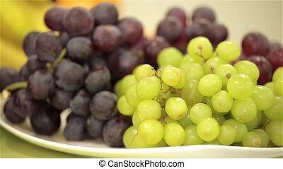 Ripe green and purple grapes, persimmon, apple - Juicy,...
