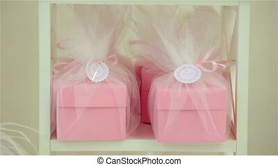 Bright, festive, pink gift, present boxes and cakes above