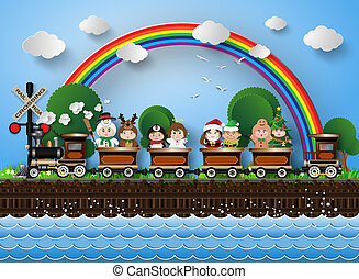 Children in fancy dress sitting on a train running on the...