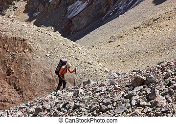 lonely woman hiking in the mountains - lonely woman with...