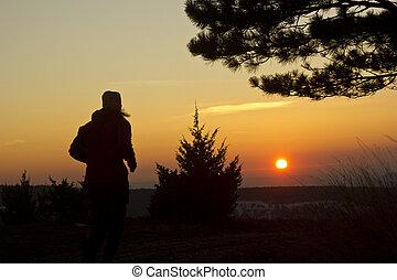 running man at sunset