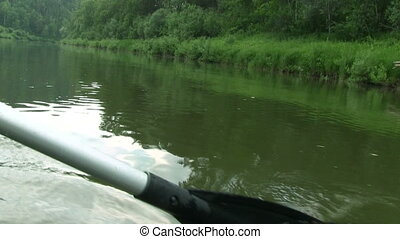 Paddle Moving Through Water - Close up footage: boat on the...