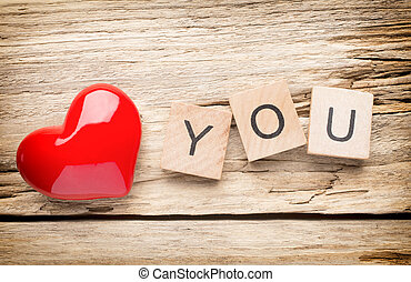 Love - Red heart on old wooden background - Stock Image I...
