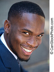 Happy young african american businessman smiling - Close up...